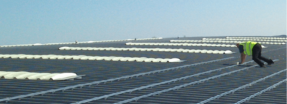 Preparing to install a commercial solar panel system on a metal roof