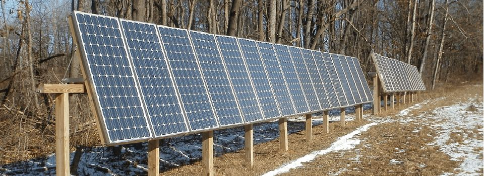 Custom constructed wooden mounts for solar panels designed for extreme weather conditions